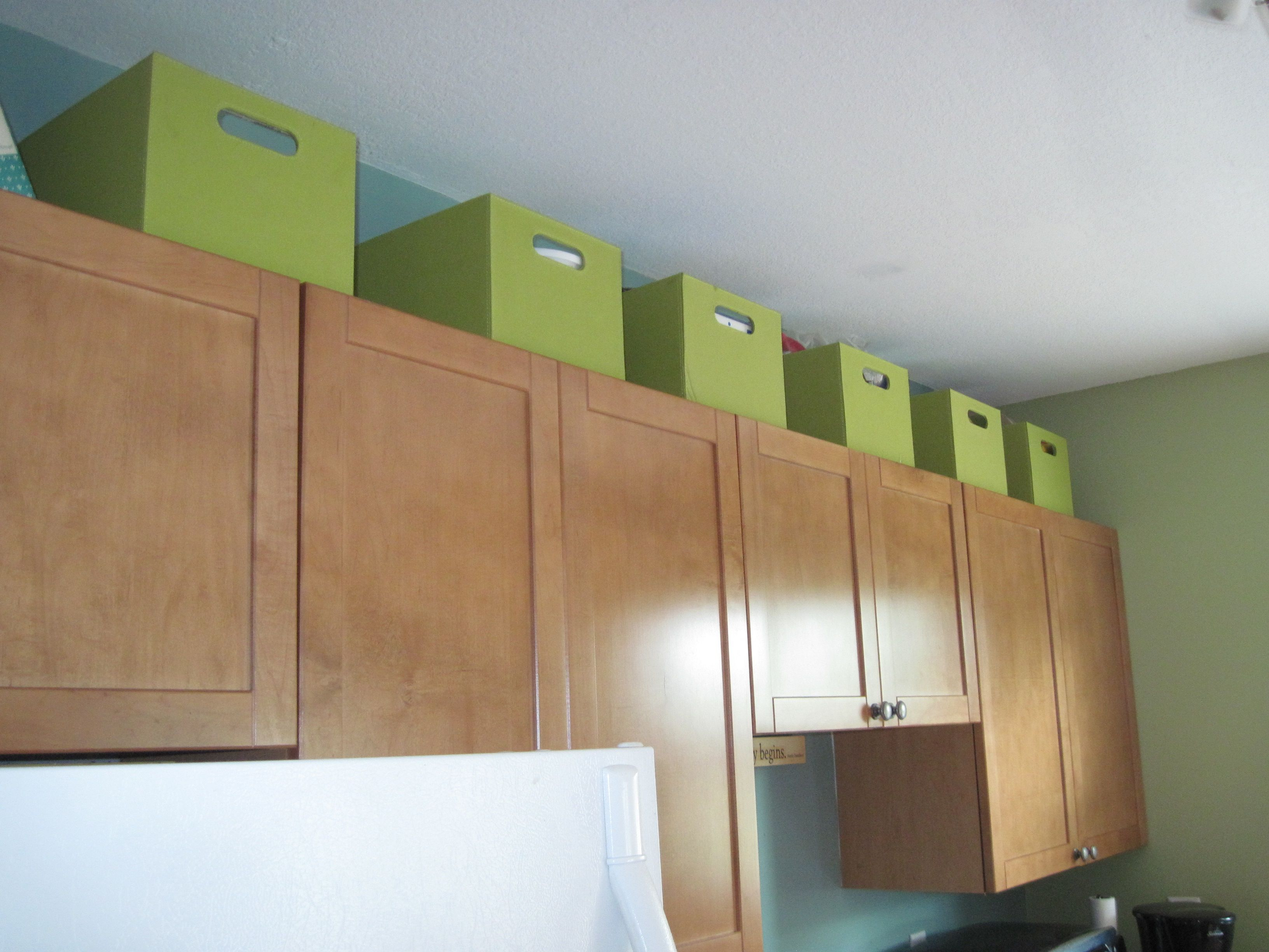 Use The Space Above Kitchen Cabinets For Extra Storage In A Small in dimensions 3264 X 2448
